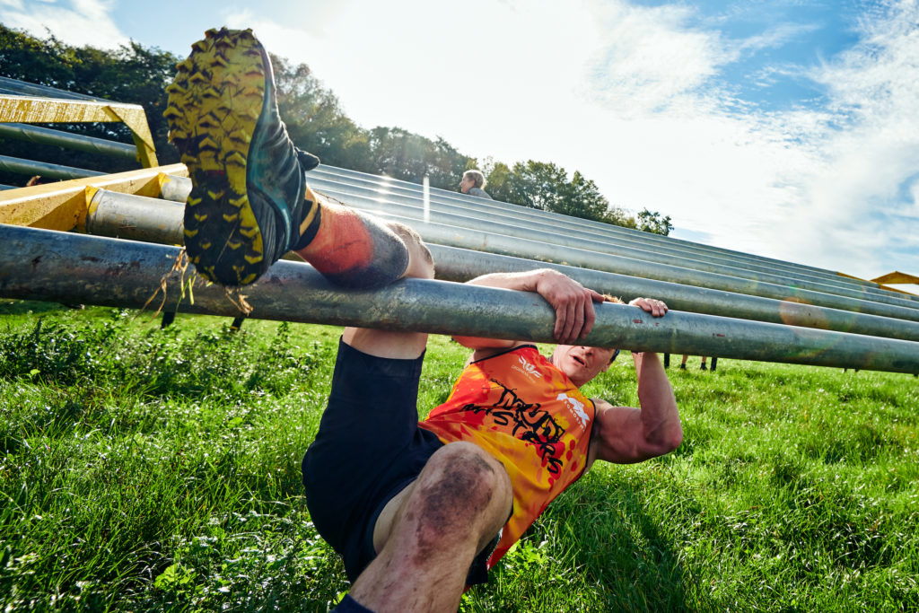 Man racing through obstacle course in UK.